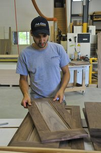 Being a local business with a reputation to maintain, quality is extremely important to Chris Moura. On a Friday afternoon, he inspects some recently finished doors.
