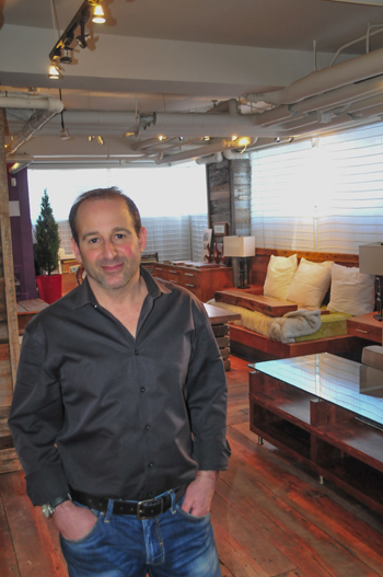 Gary Litwin, in the upper showroom of Union Square Vintage Wood Co.