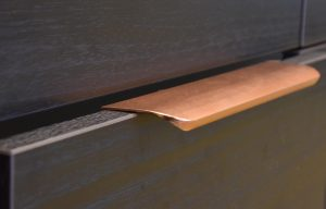 Drawer edge pulls in rose gold anodized aluminum