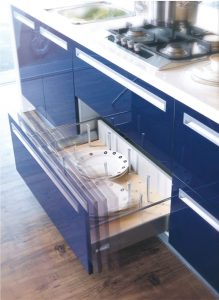 Cabinet hardware includes hinges, drawer systems and drawer slides