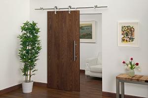Barn door hardware for interior applications