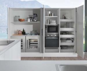 Pocket door system optimizes cabinet space